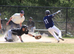 Third Basemen, Jeff Costello gets around the attempted tag and scored 3rd Mustangs run of the game.