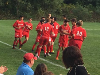 Holliston celebrates after defeating Hopkinton 2-0 on the road to improve to 4-0 on the season.